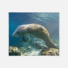 Florida manatee swimming Throw Blanket