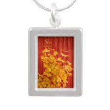 Yellow leaves against a  Silver Portrait Necklace