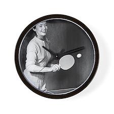 Woman playing table tennis Wall Clock