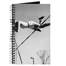 Male pole-vaulter clearing bar Journal