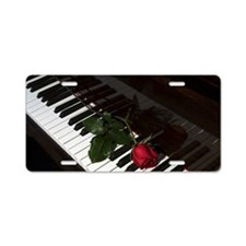 Rose on a piano Aluminum License Plate