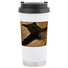 A bear skin rug on wooden floor Travel Mug