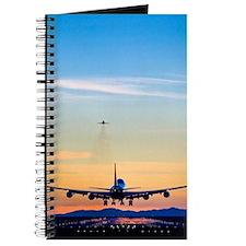Aeroplane landing, Canada Journal