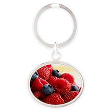 Blueberries and raspberries Oval Keychain