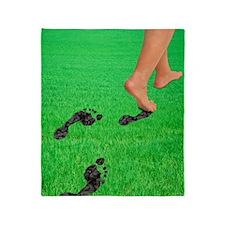 A woman's feet leaving carbon footpr Throw Blanket