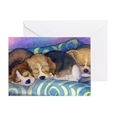 Beagle puppies asleep on the sofa Greeting Card