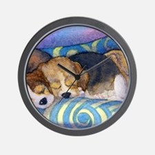 Beagle puppies asleep on the sofa Wall Clock