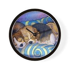 Beagle puppies asleep on the sofa Wall Clock