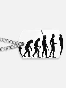 evolution trumpet player Dog Tags