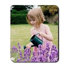 Young girl watering flowers Mousepad