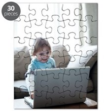 Young child playing with a laptop Puzzle