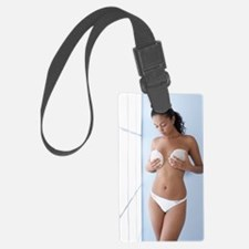 Woman holding breast implants Luggage Tag