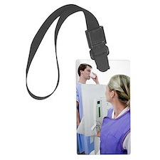 Man swallowing barium during an  Luggage Tag