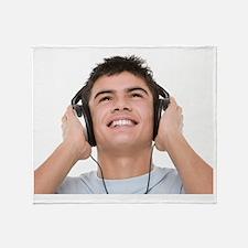 Teenage boy listening to music Throw Blanket