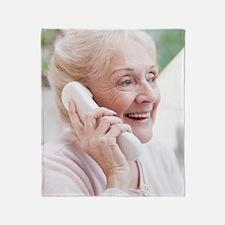 Senior woman talking on the telephon Throw Blanket