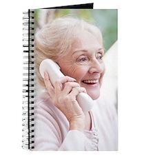 Senior woman talking on the telephone Journal
