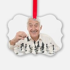 Senior man playing chess Ornament