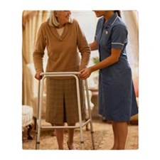 Senior woman with walking frame Throw Blanket