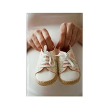 Pregnant woman holding baby shoes Rectangle Magnet