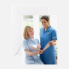 Nurses checking notes Greeting Card