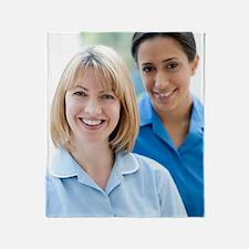 Nurses smiling Throw Blanket