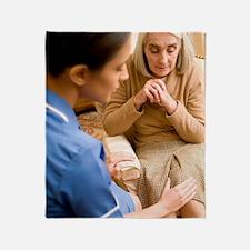 Nurse on a home visit Throw Blanket