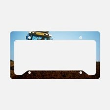 View of a tractor ploughing a License Plate Holder