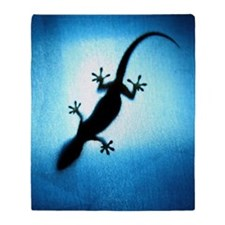 Silhouetted gecko Throw Blanket