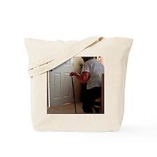 Using a walking stick Tote Bag