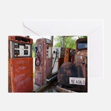 Rusty gas pumps and car Greeting Card