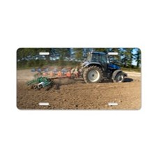 Tractor ploughing a field Aluminum License Plate