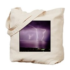Thunderstorm at night over lake Tote Bag