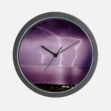 Thunderstorm at night over lake Wall Clock