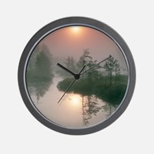 Sunrise over a river Wall Clock