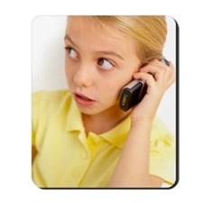 Girl using mobile phone Mousepad
