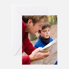 Father and son reading a map Greeting Card