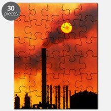 Smoking chimneys of an oil refinery at suns Puzzle