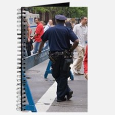 New York policeman leaning on barrier Journal