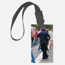 New York policeman leaning on ba Luggage Tag