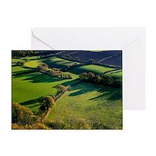 Shadows across fields, Devon, UK Greeting Card