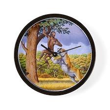 Scimitar cat attacking a hominid Wall Clock