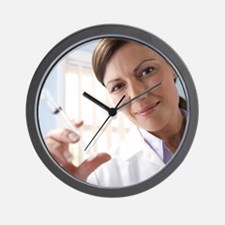 Doctor preparing an injection Wall Clock
