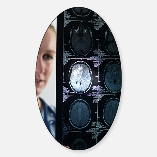 Doctor studying an MRI scan Sticker (Oval)