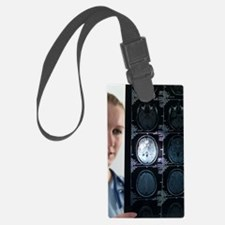Doctor studying an MRI scan Luggage Tag