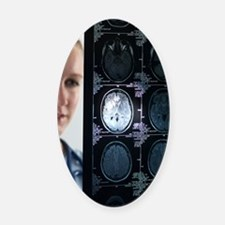 Doctor studying an MRI scan Oval Car Magnet