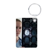 Doctor studying an MRI sca Keychains