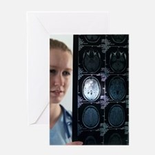 Doctor studying an MRI scan Greeting Card