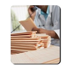 Doctor discussing medical records Mousepad