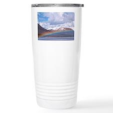 Rainbow over a lake Travel Mug