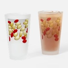 Cod liver oil and Nurofen capsules Drinking Glass